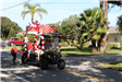 golf cart decorated with wrapped presents on top