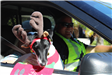 dog with reindeer antlers and Sergeant Rudd driving police vehicle